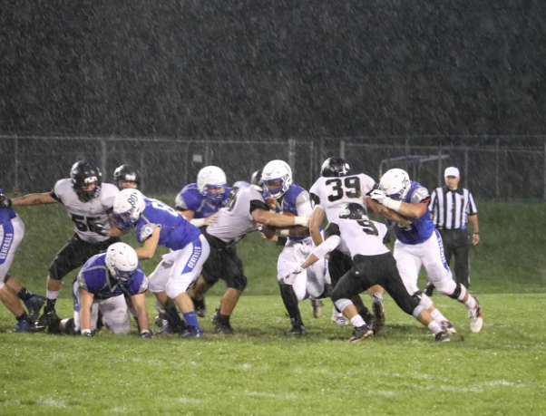 PHS student athlete playing football