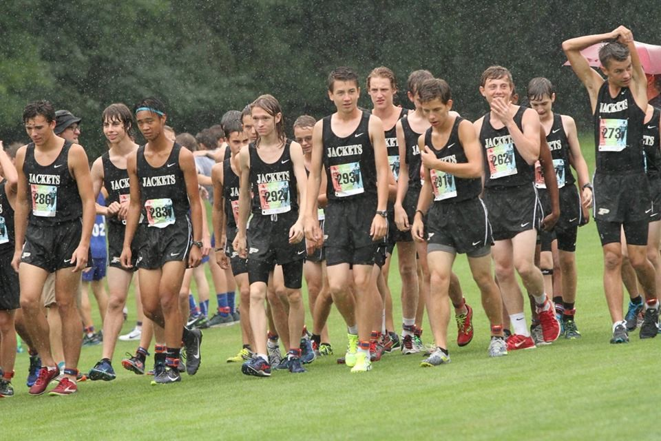 PHS boys cross country runners competing at a meet
