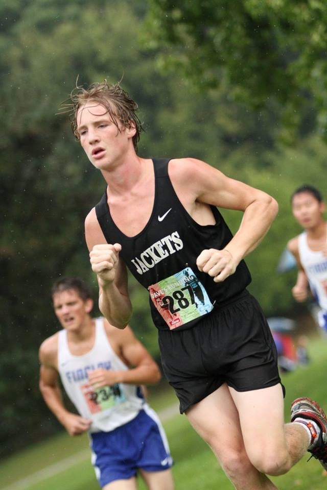 PHS boys cross country runner competing at a meet