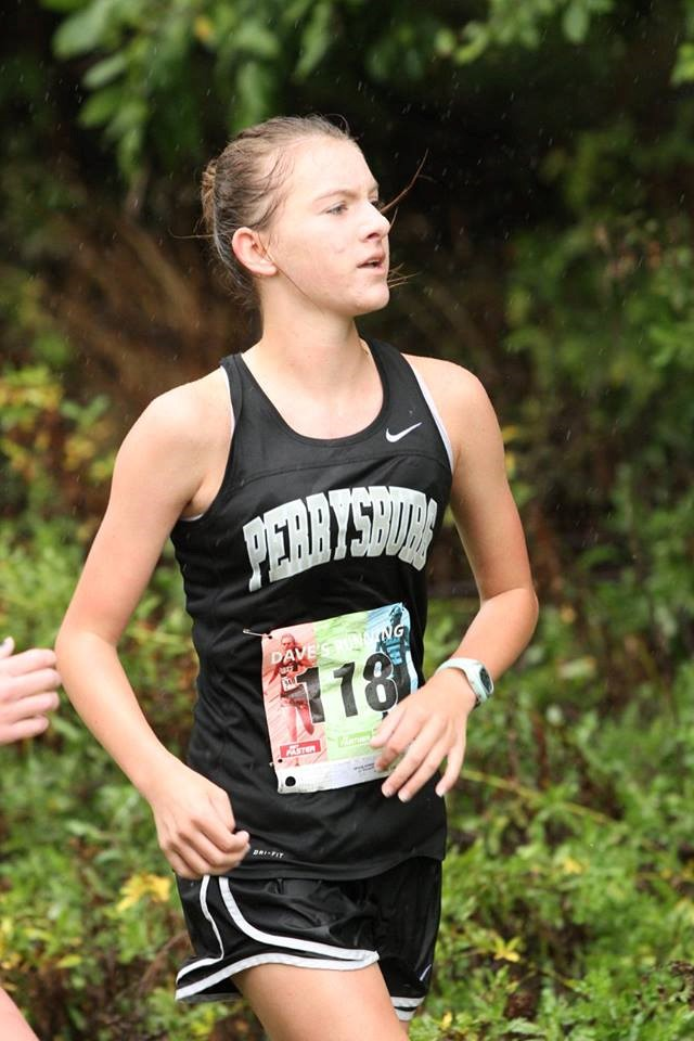 PHS girls cross country runners competing at a meet