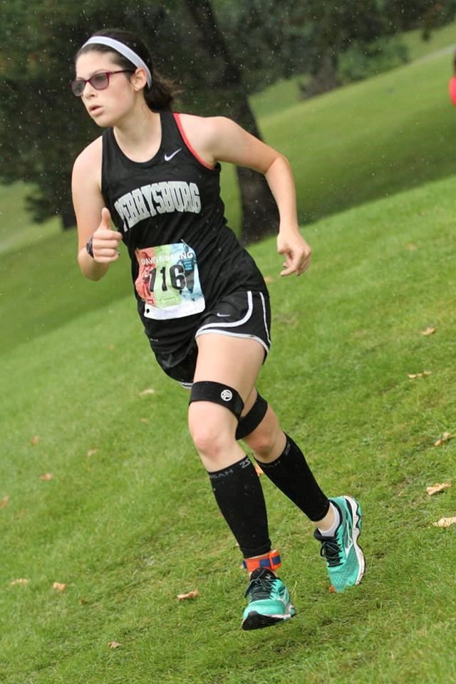 PHS girls cross country runner competing at a meet