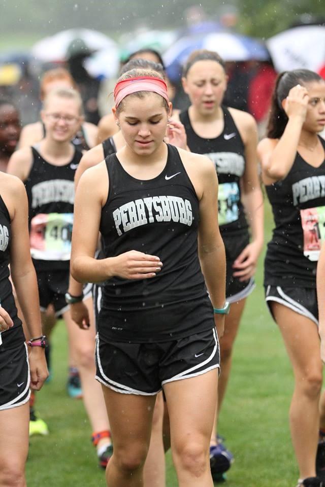 PHS girls cross country runners walking to the start line