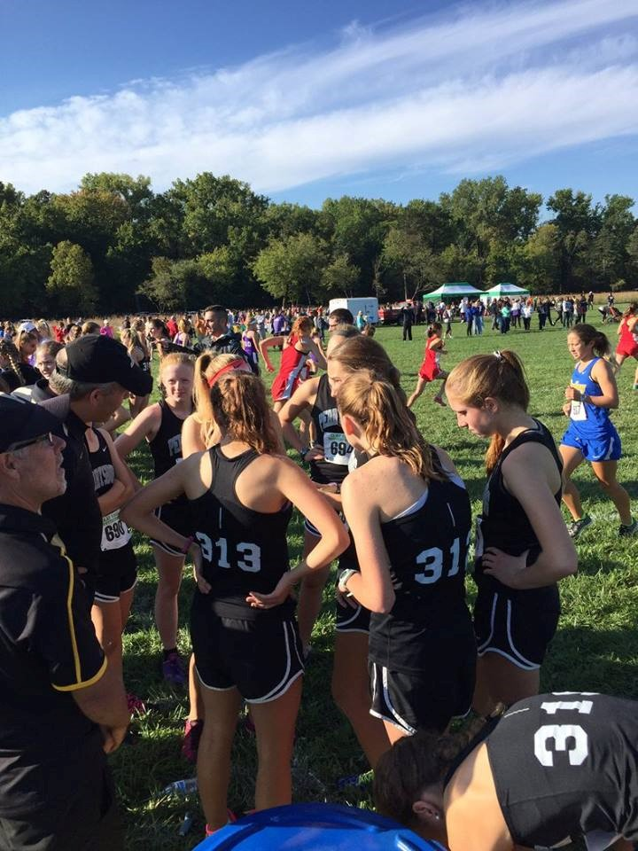 PHS girls cross country runners preparing for the race