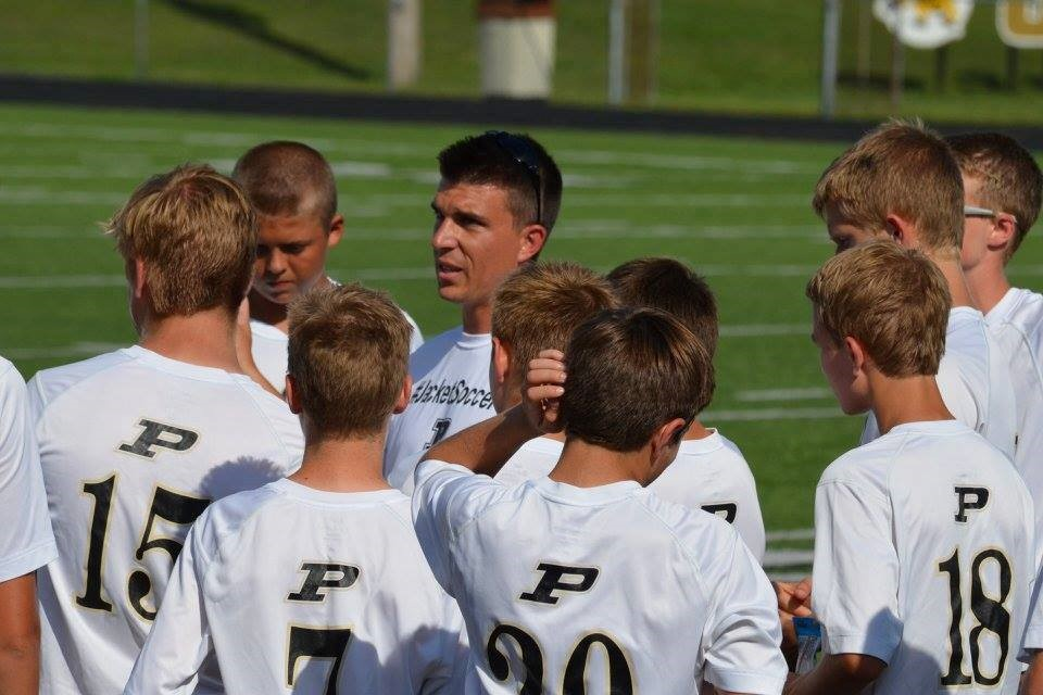 PHS soccer players listening to their coach