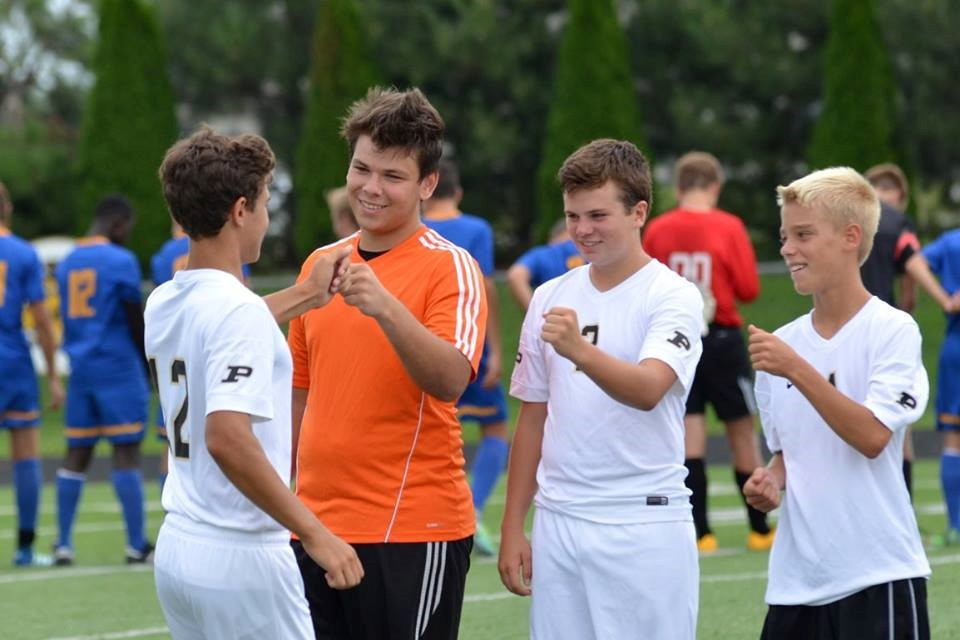 PHS soccer players celebrating a goal