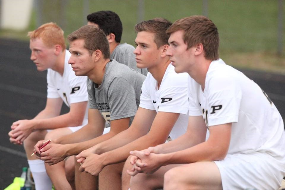 PHS soccer players sitting on the bench