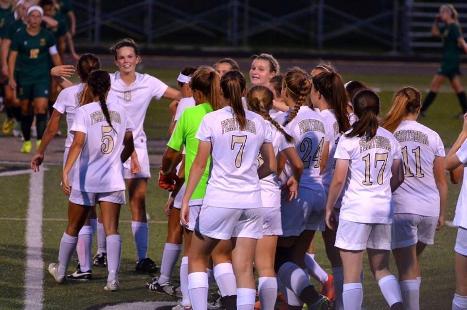 PHS girls soccer team celebrating a victory