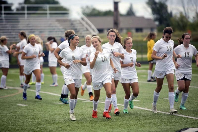 PHS girls soccer team warming up