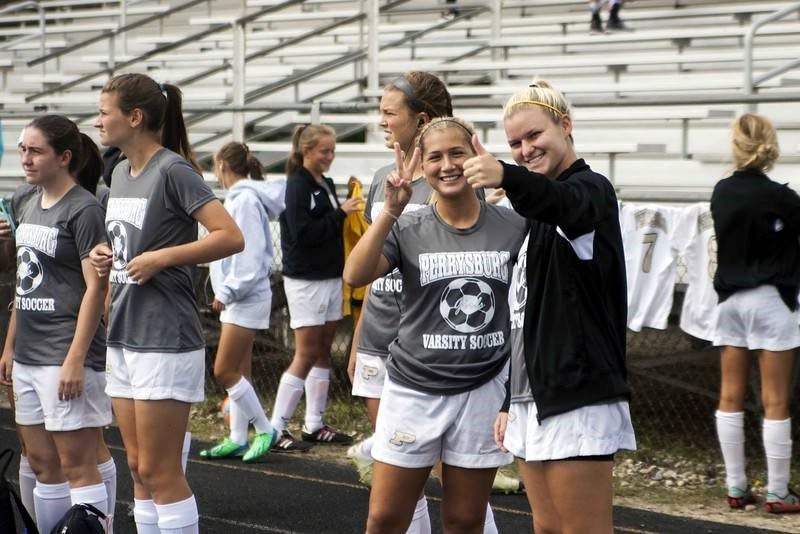 PHS soccer players happy before the game