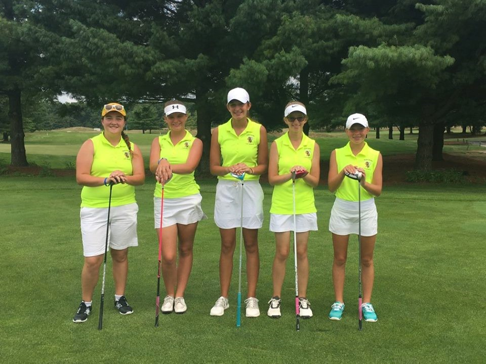 PHS girls golf team posing for a photo before a match