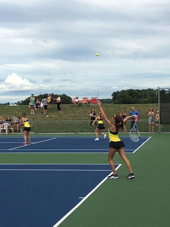 PHS student athlete hitting a tennis ball