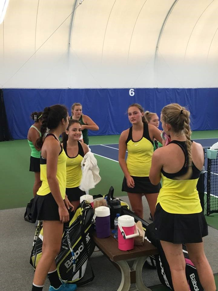 PHS girls tennis team talking between sets