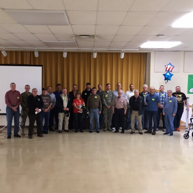 Large group photo of participants in Veterans Day program 2016