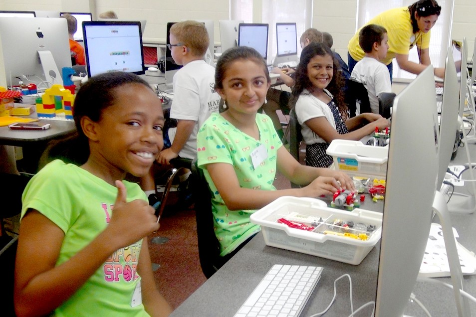 Student giving thumbs-up in computer lab