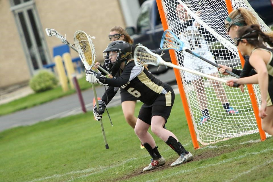 PHS girls lacrosse goalie making a save
