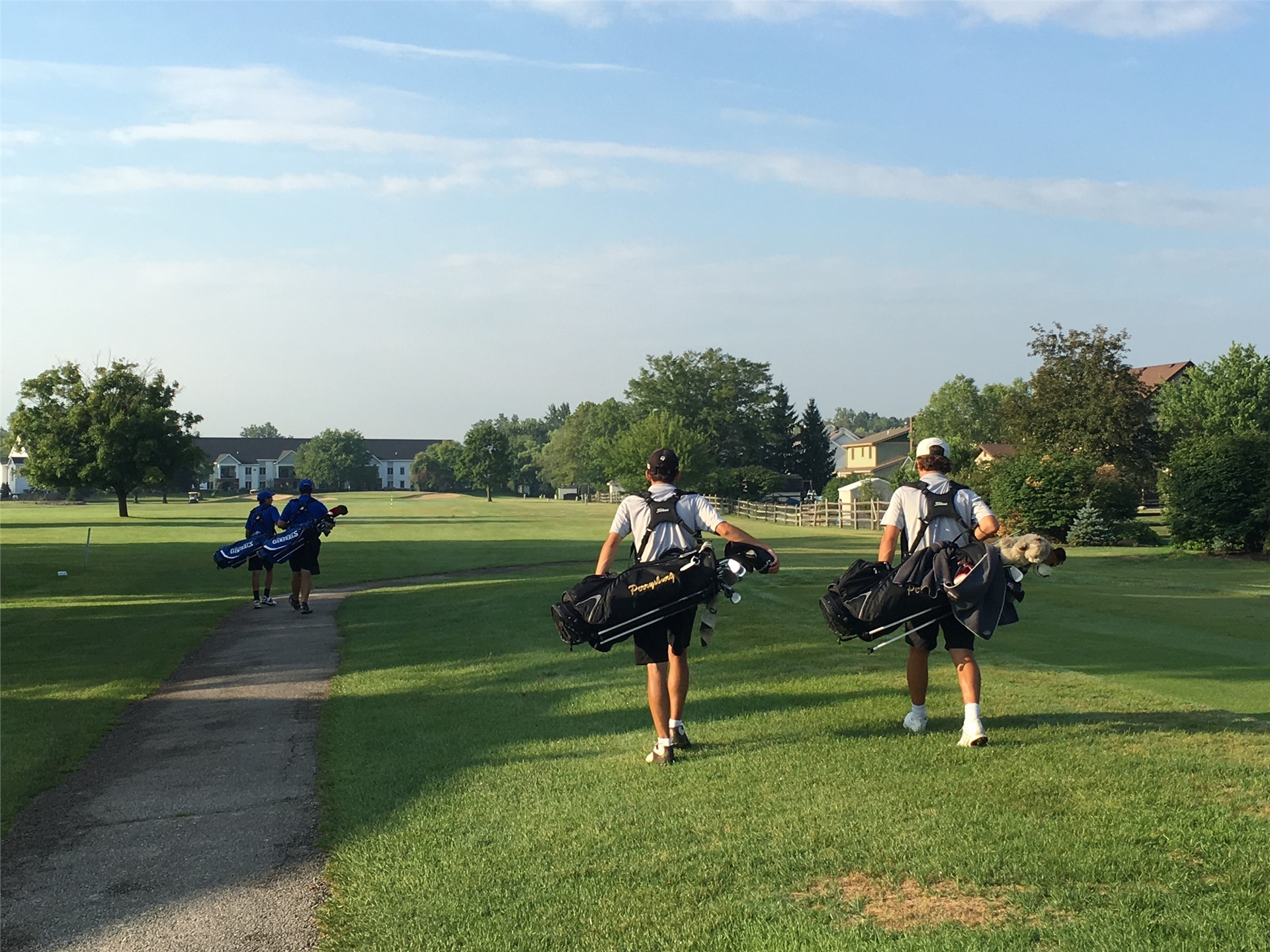 PHS student athletes walking down the fairway