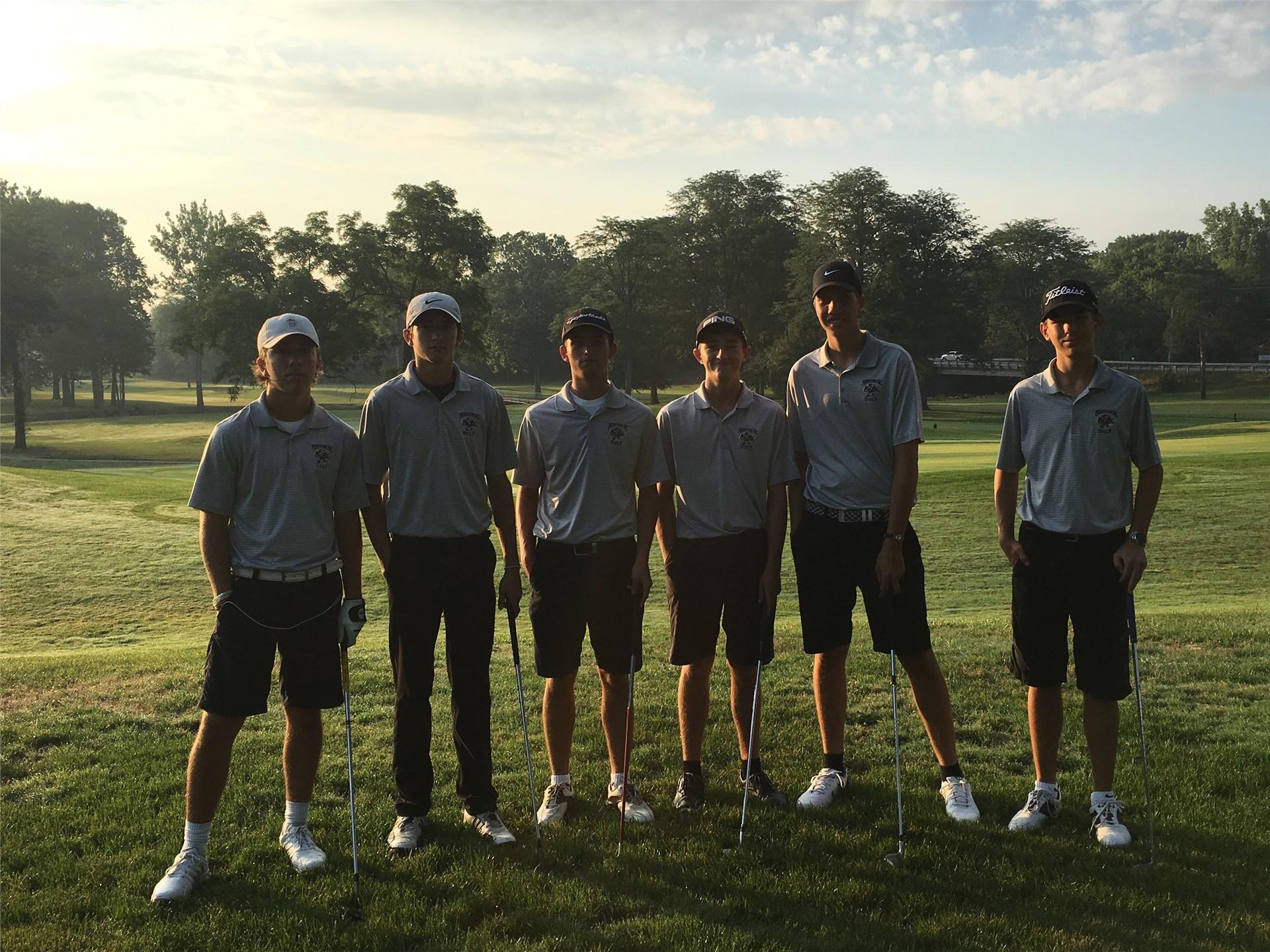 PHS boys golf team posing before the match