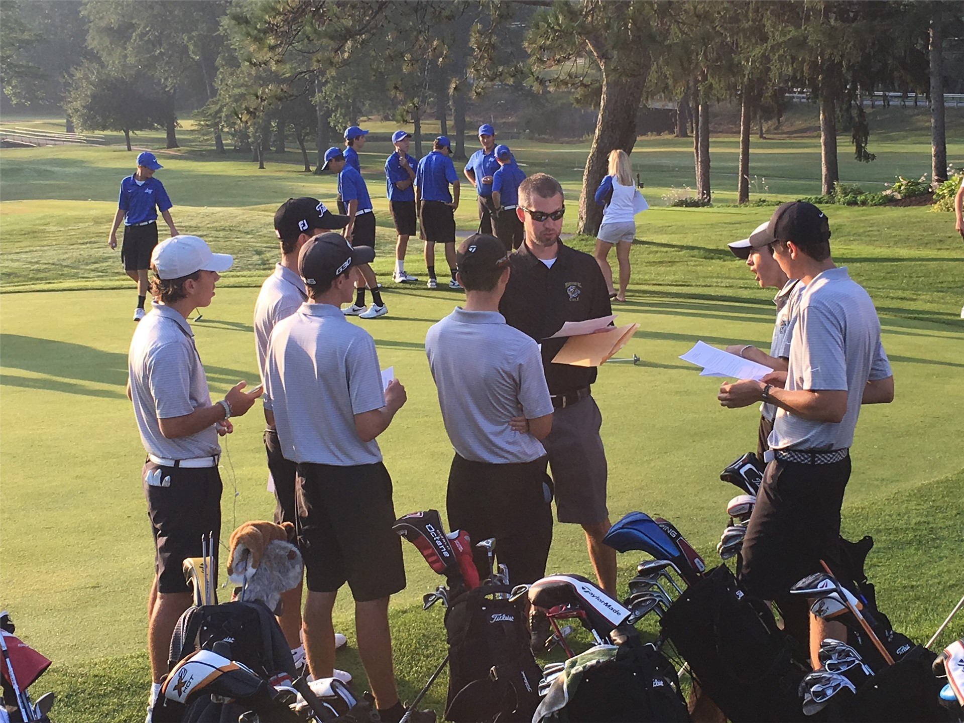 PHS boys golf team listening to coach before the match