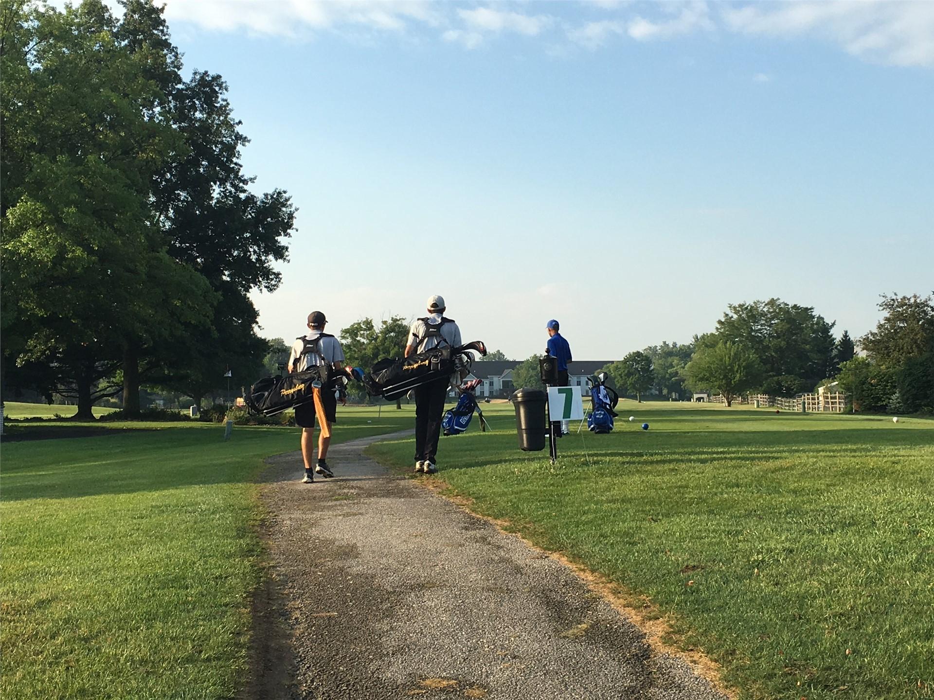 PHS student athletes walking to their golf balls