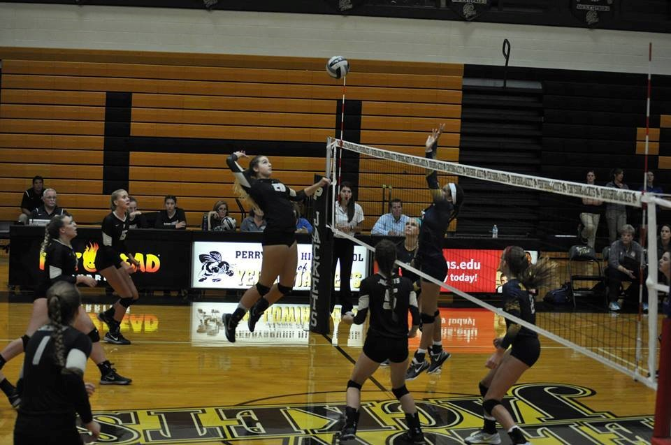 PHS volleyball player spiking a volleyball