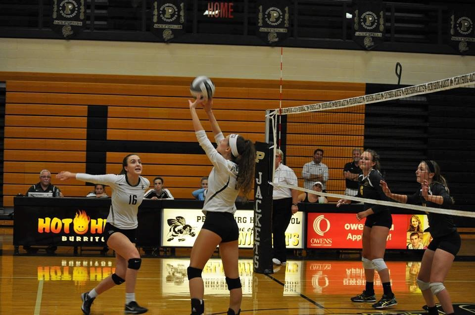 PHS volleyball player setting a volleyball