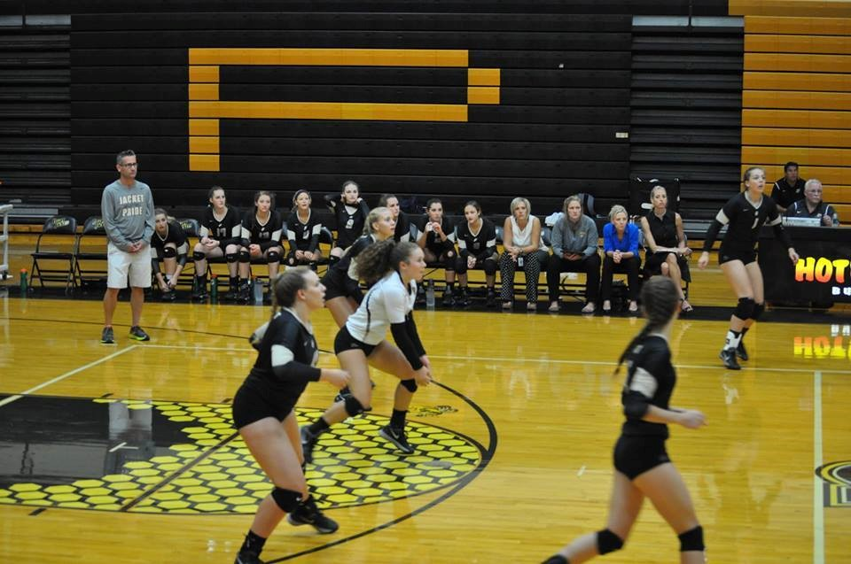 PHS volleyball players returning a serve