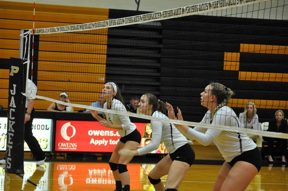 PHS volleyball players waiting on a serve