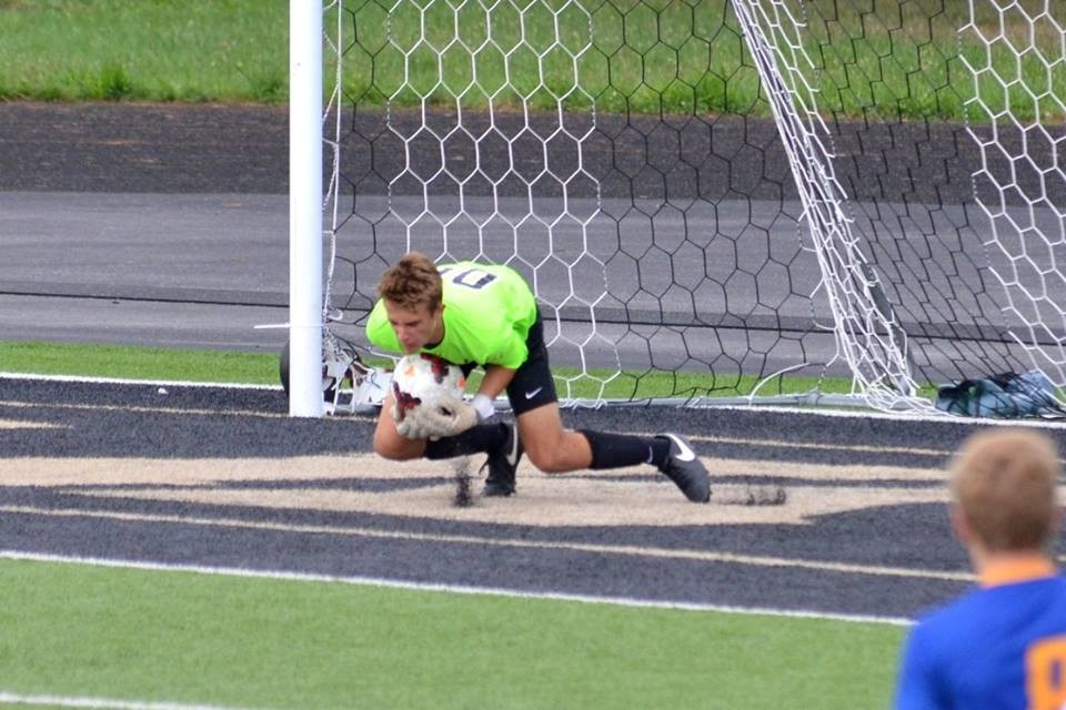 PHS soccer goalie stopping a shot