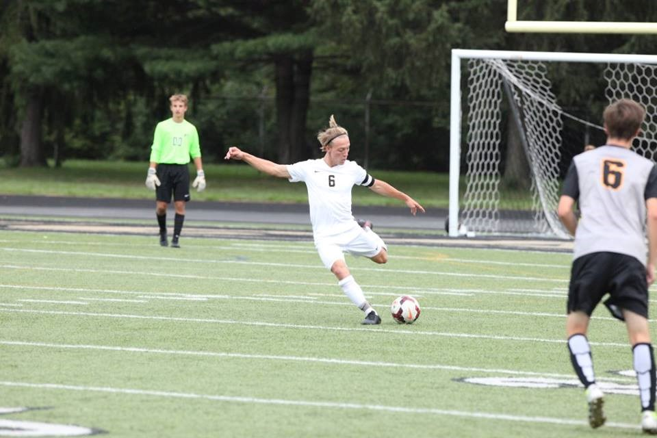 PHS soccer player kicking a soccer ball