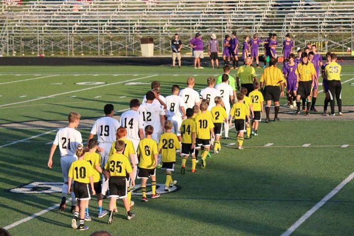 PHS boys soccer team at a hand shake before the game
