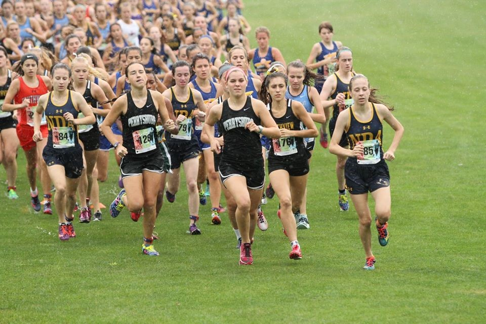 PHS girls cross country team running at a meet