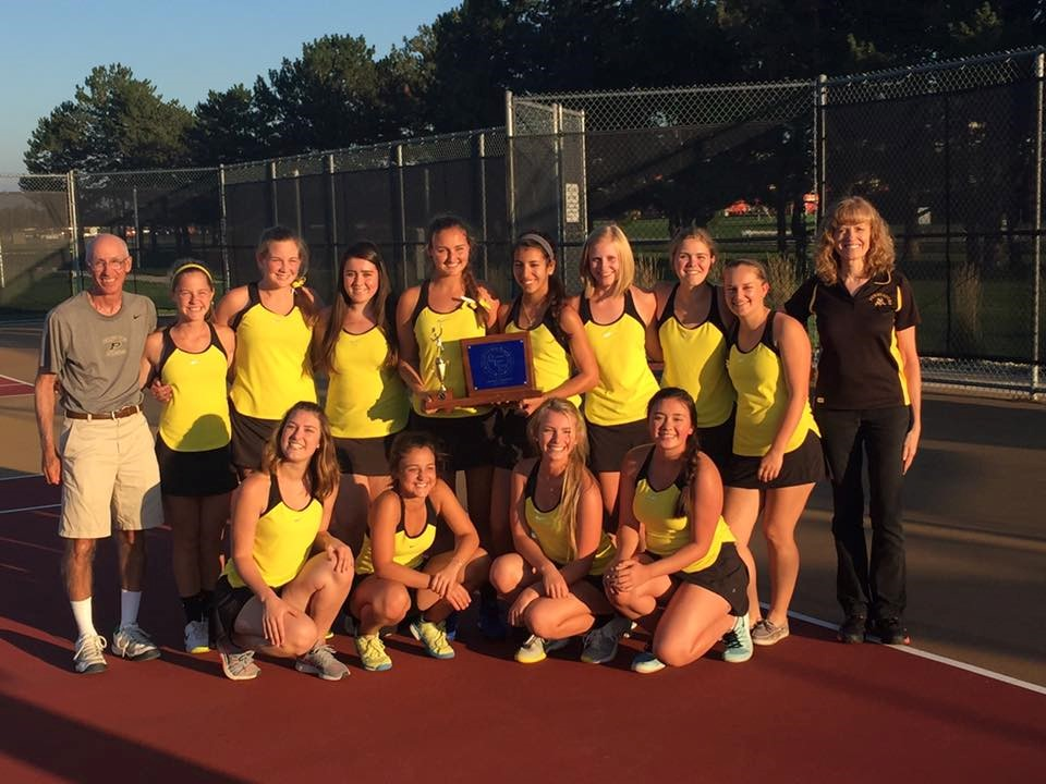 PHS girls tennis team celebrating a league championship