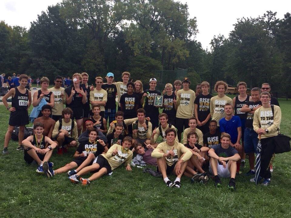 PHS boys cross country team group photo at a meet