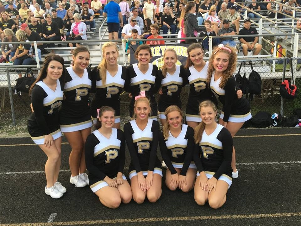 PHS cheerleaders posing at a football game