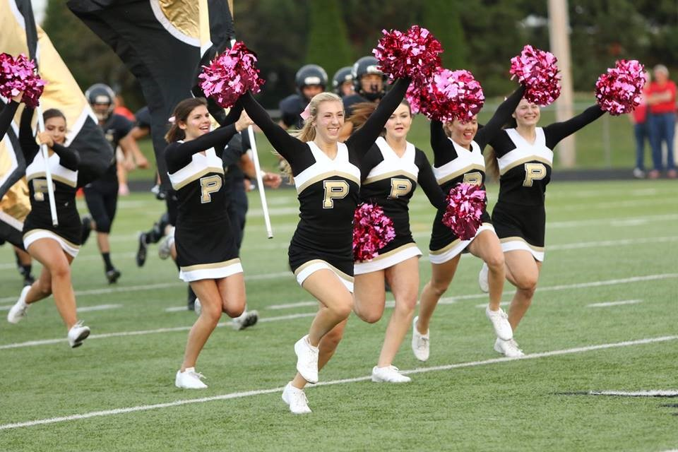 PHS cheerleaders running onto the football field