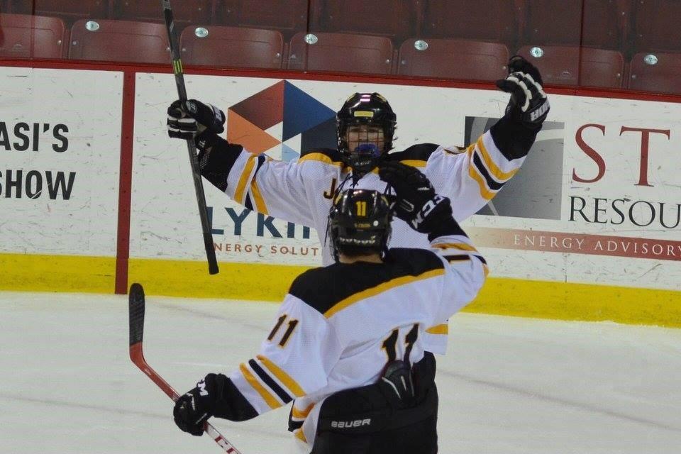 PHS hockey players celebrating a goal