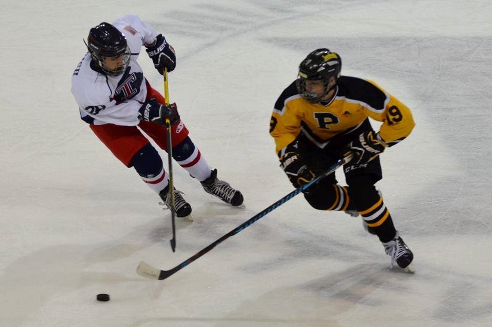 PHS hockey player handling a puck