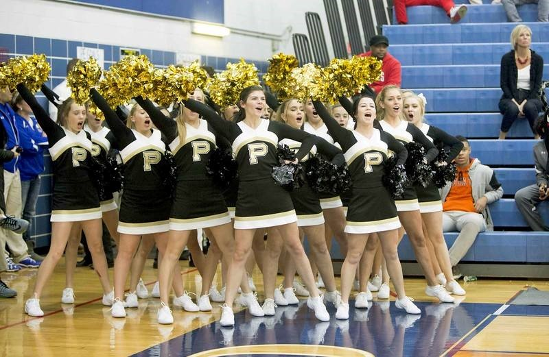 PHS cheerleaders cheering at a basketball game