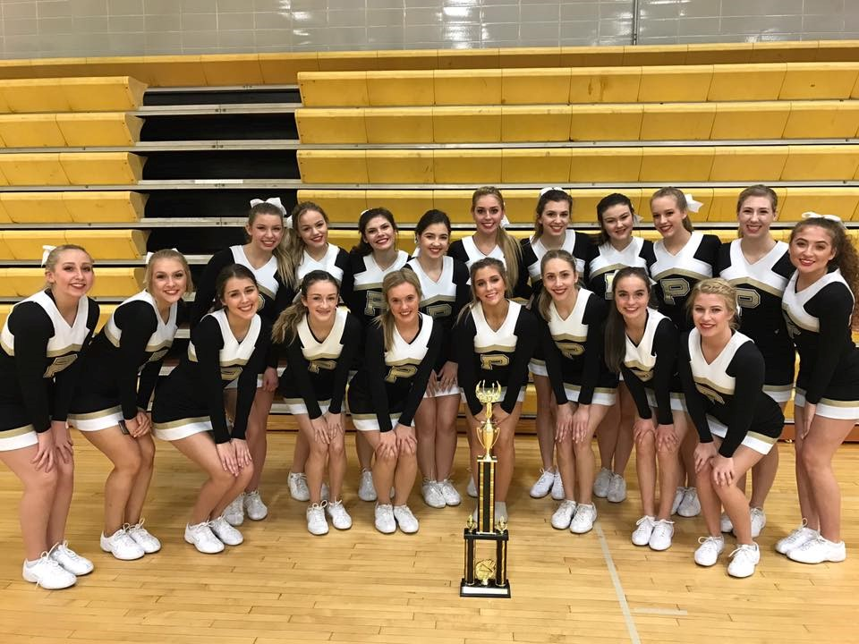 PHS cheerleaders posing after a competition victory