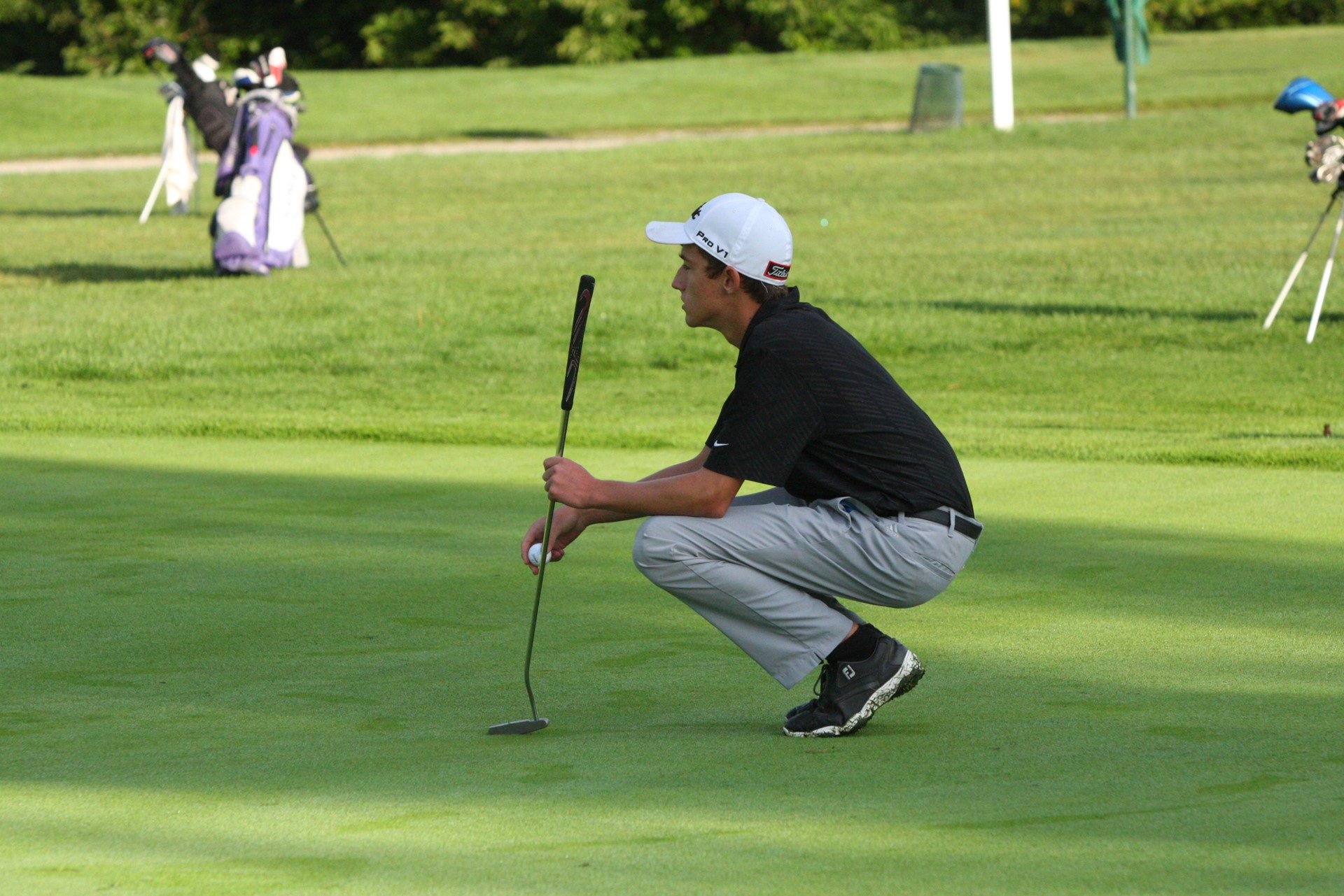 PHS student athlete pondering a putt