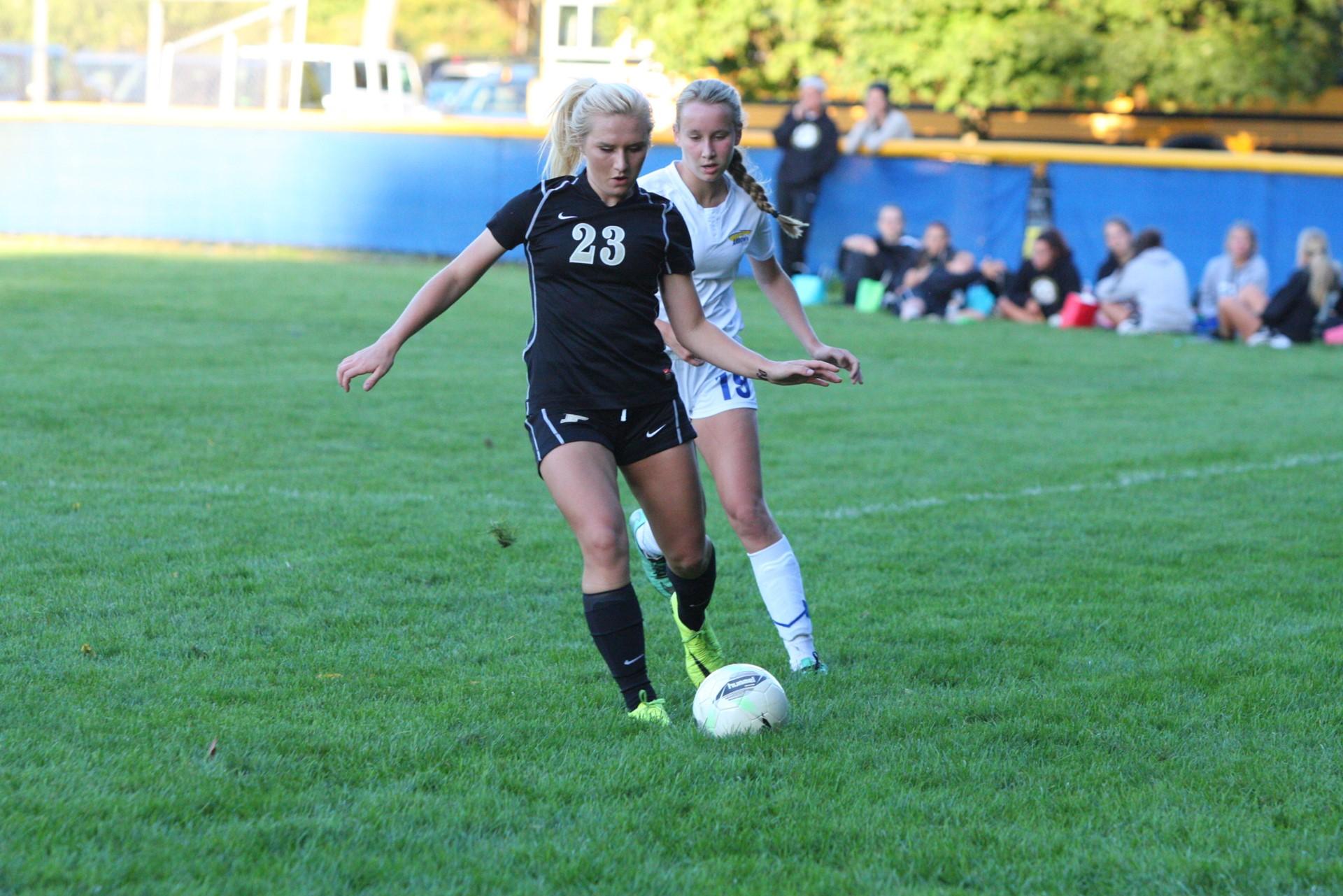 PHS student athlete kicking a soccer ball