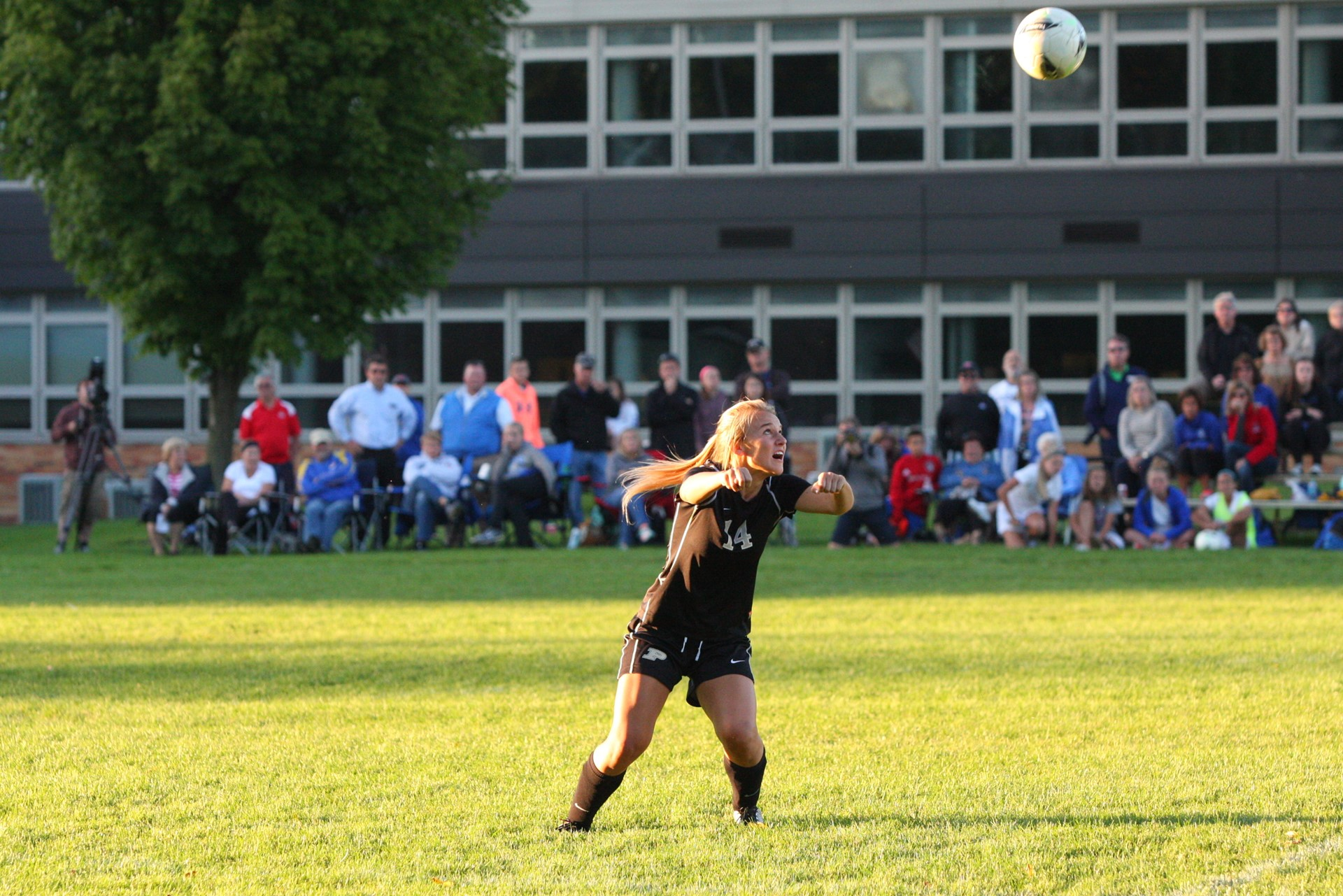 PHS student athlete heading a soccer ball