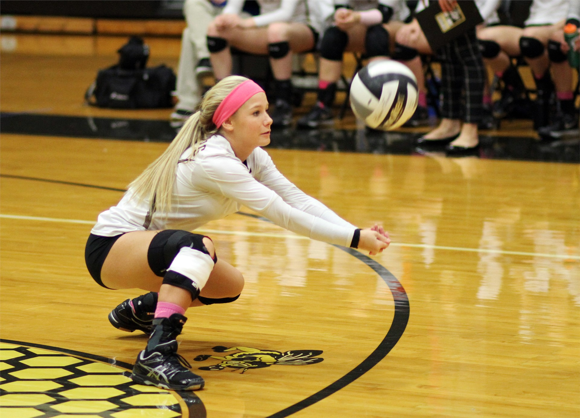 PHS volleyball players attempting to bump a ball