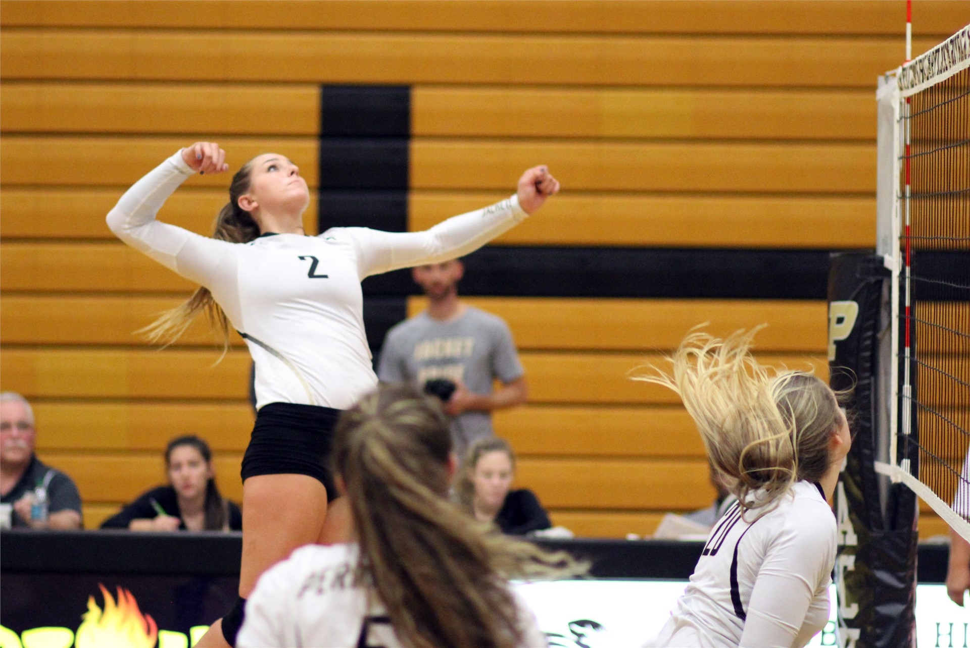 PHS volleyball players attempting to spike a shot