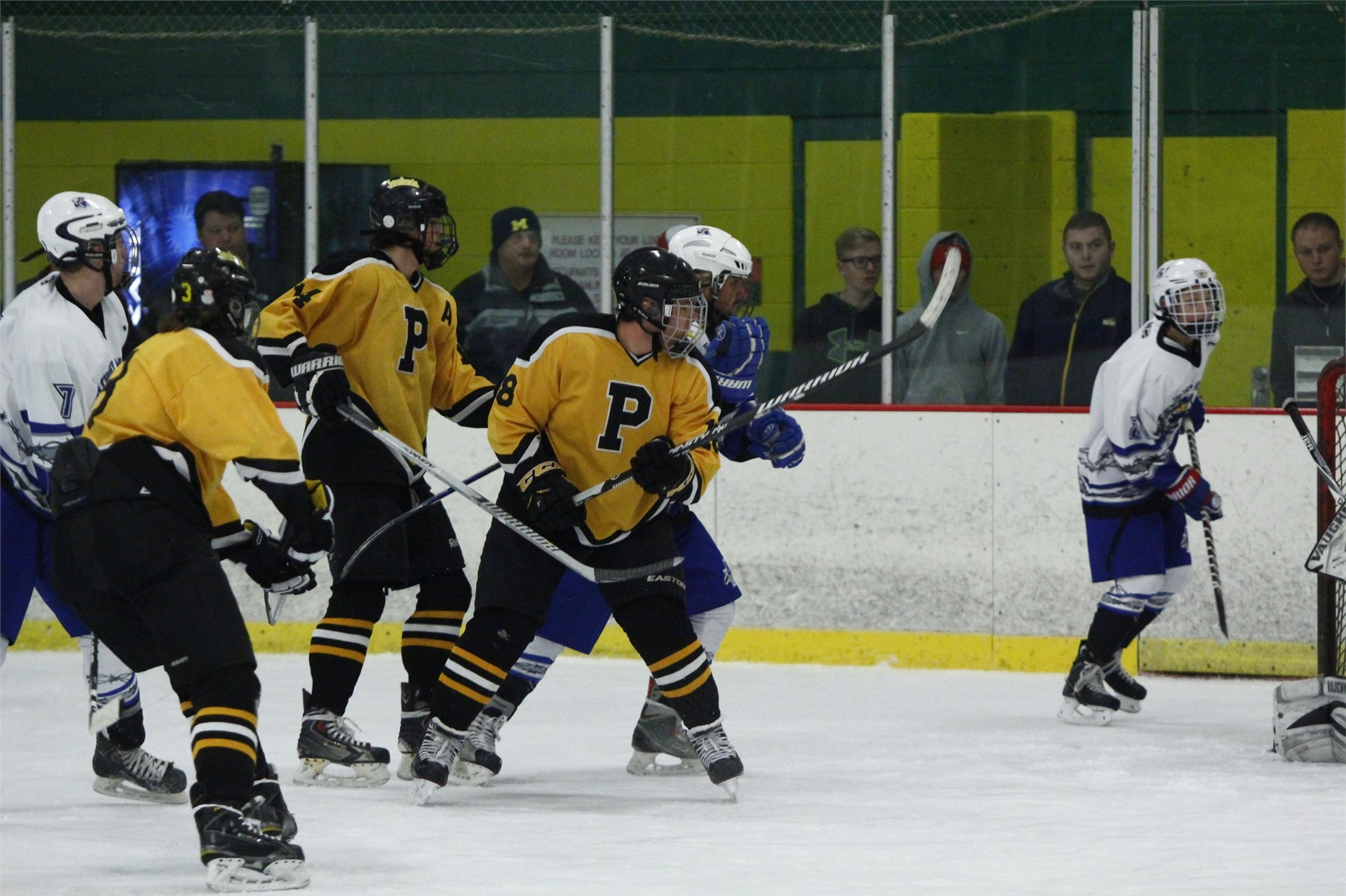 PHS hockey team competing at a game