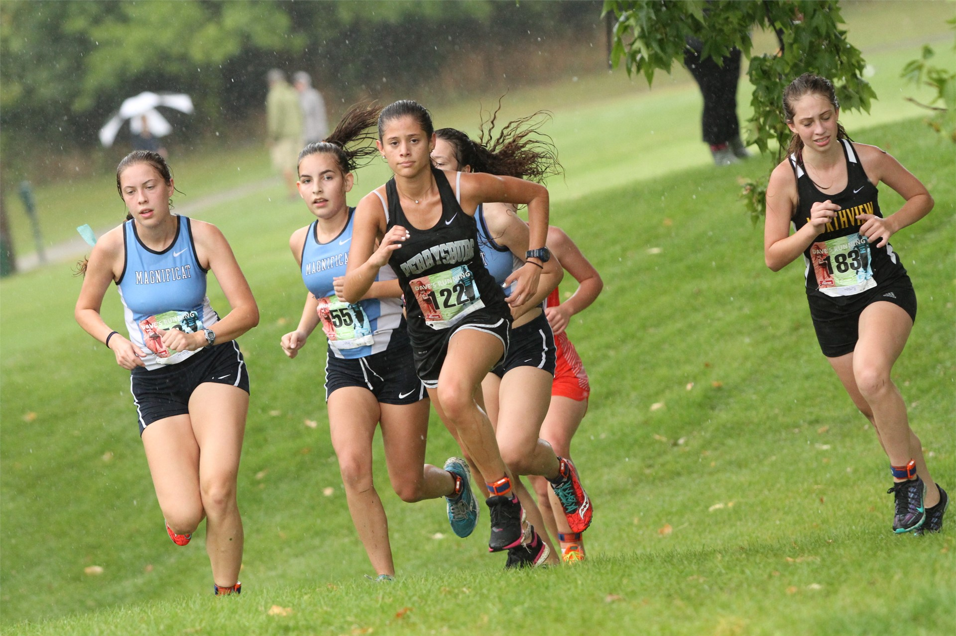 PHS girls cross country runners competing