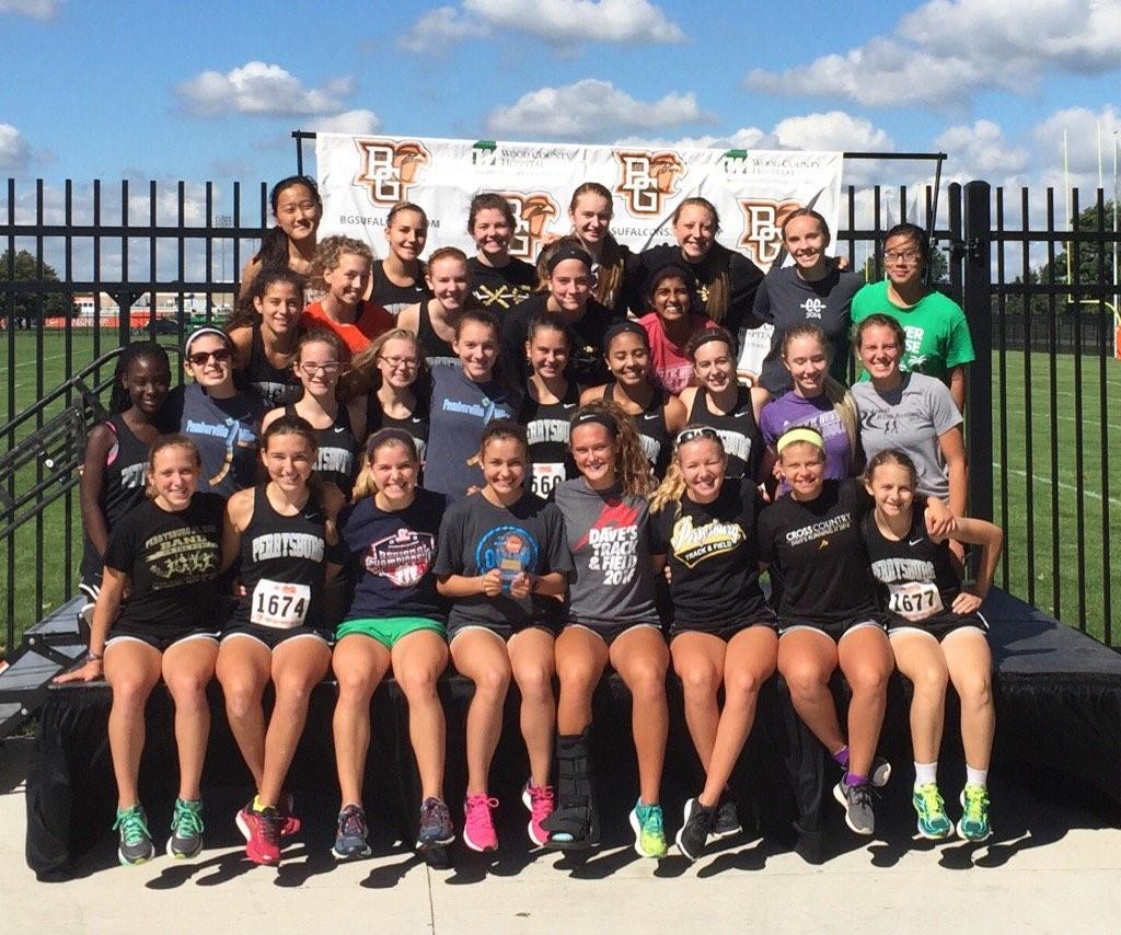PHS girls cross country team celebrating victory