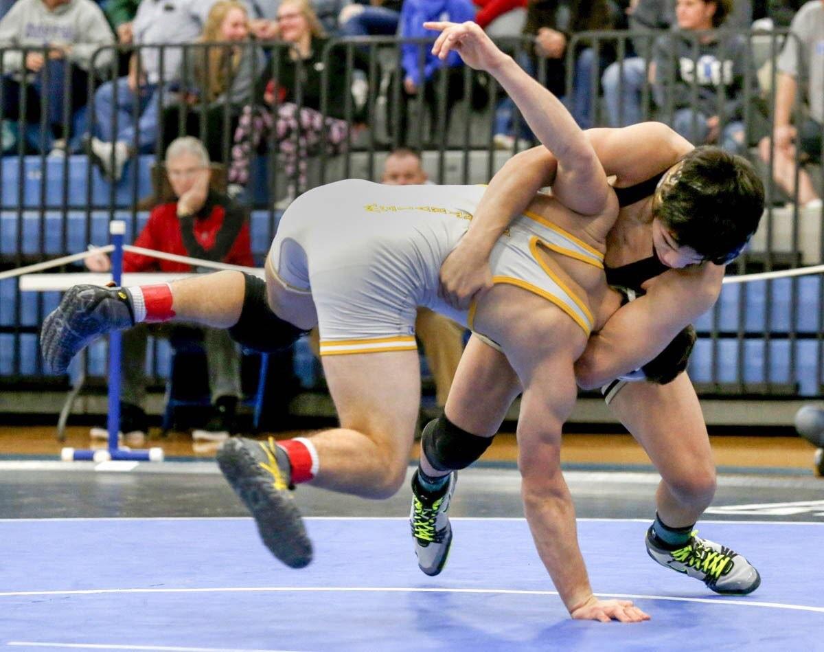 PHS student athlete wrestling at a tournament