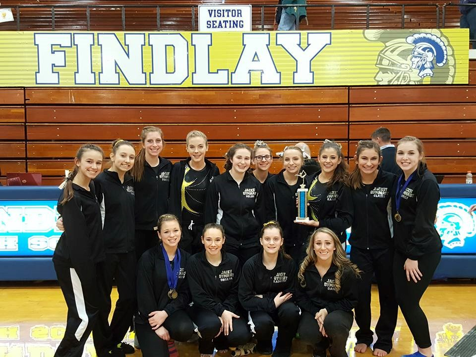 PHS gymnasts celebrating victory after a competition