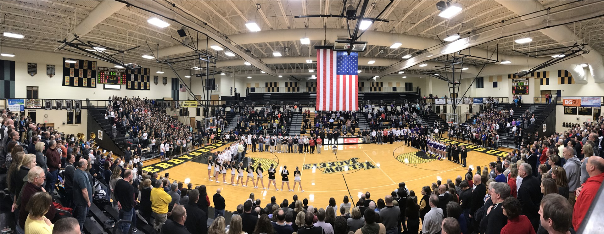 PHS crowd standing for the national anthem in the gym